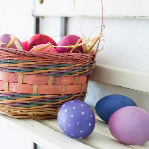Easter eggs on a shelf in a basket